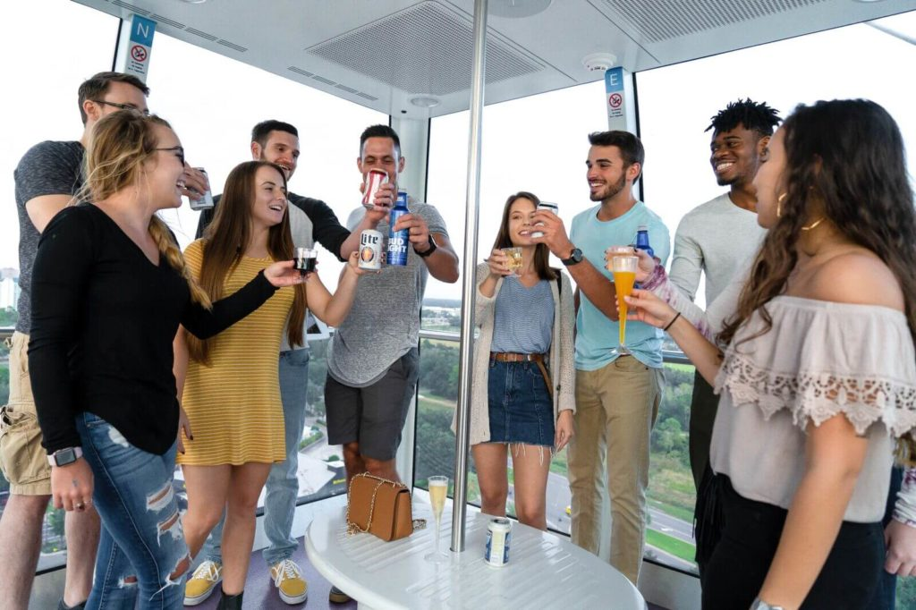 Ride ICON Orlando's Sky Bar 360 in a VIP capsule of the observation wheel with bottomless beer, wine, and Prosecco.
