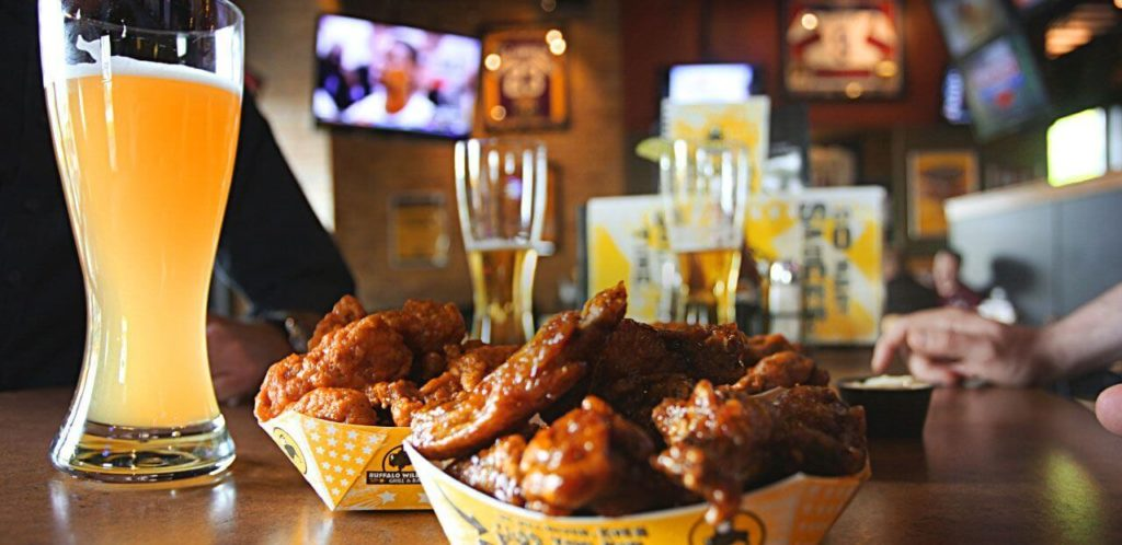 Buffalo Wild Wings at Icon Orlando 360 serves their signature wings and a pint of beer while you watch the game with friends.